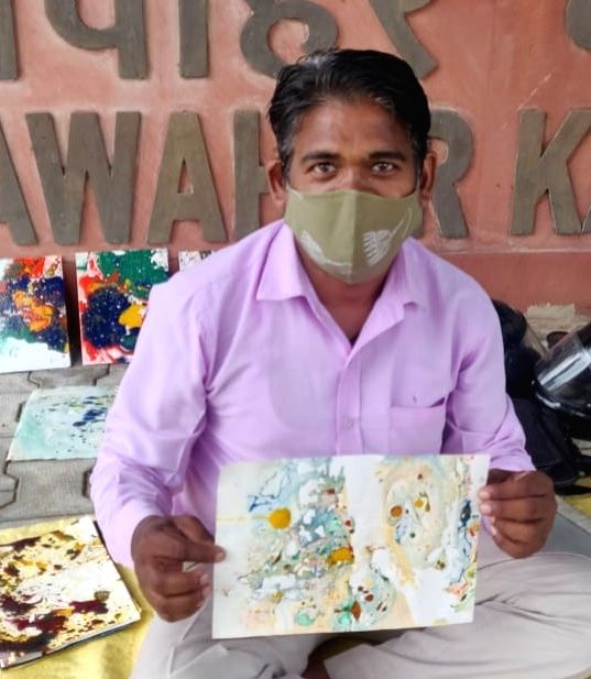 COVID hit school teacher starts selling his paintings on streets