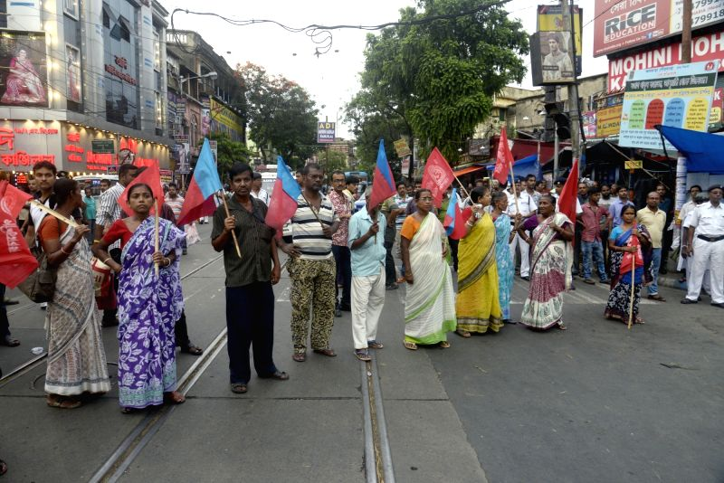 CPI activists stage a demonstration against West Bengal Government in Kolkata on June 12, 2017.
