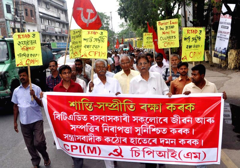 CPI (M) activists taking out a procesion in Guwahati on May 3, 2014, against the brutal killing of innocent people in BTAD area of Assam.