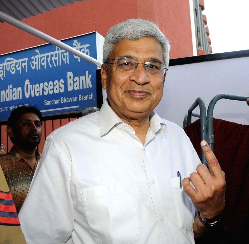 CPI-M General Secretary Prakash Karat shows his fore finger marked with phosphoric ink after casting his vote during the third phase of 2014 Lok Sabha Polls in New Delhi on April 10, 2014. Elections .