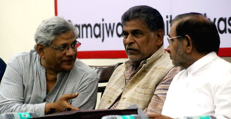 CPI-M general secretary Sitaram Yechury and JD(U) leader Sharad Yadav during a programme organised to celebrate birth anniversary of socialist essayist and activist Madhu Limaye in New ... - Sitaram Yechury and Sharad Yadav