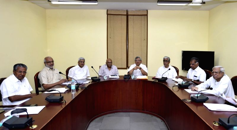 CPI-M General Secretary Sitaram Yechury, Kerala Chief Minister Pinarayi Vijayan, Tripura Chief Minister Manik Sarkar, party leader Prakash Karat and other leaders during CPI-M politburo ... - Pinarayi Vijayan and Sitaram Yechury