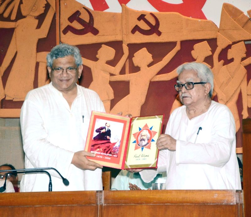 CPI-M general secretary Sitaram Yechury, Left Front chairman Biman Bose during a programme organised on Karl Marx's birth anniversary in Kolkata, on May 5, 2017. - Sitaram Yechury and Biman Bose