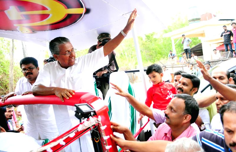 CPI-M leader Pinarayi Vijayan celebrates party's performance in the recently concluded Kerala Assembly polls in Kannur on May 19, 2016.