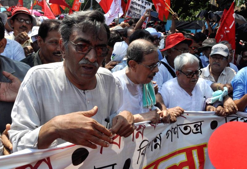 CPI-M leader Surjya Kanta Mishra and Left Front chairman Biman Bose arrives to participate in a rally to protest against unemployment, farmers' distress and other issues in Kolkata, on May ... - Surjya Kanta Mishra, Biman Bose and Sujan Chakraborty