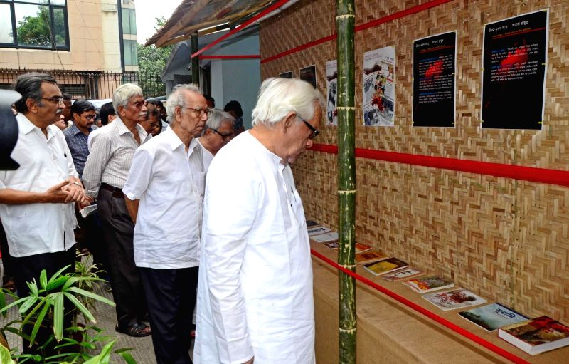 CPI-M leaders Buddhadeb Bhattacharjee, Biman Bose, Surjya Kanta Mishra and others during inauguration of an exhibition on 128th birth anniversary of CPI-M leader Muzaffar Ahmad in Kolkata, ... - Biman Bose and Surjya Kanta Mishra