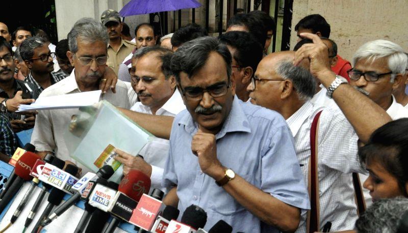 CPI-M state secretary Surja Kanta Mishra talks to press after meeting West Bengal Governor Keshari Nath Tripathi at Raj Bhawan in Kolkata, on May 23, 2016. - Surja Kanta Mishra and Keshari Nath Tripathi