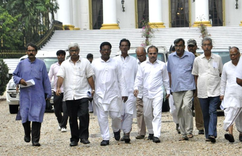 CPI-M state secretary Surja Kanta Mishra, West Bengal Congress president Adhir Ranjan Chowdhury and other Congress and Left leaders come out after meeting with West Bengal Governor ... - Surja Kanta Mishra and Keshari Nath Tripathi