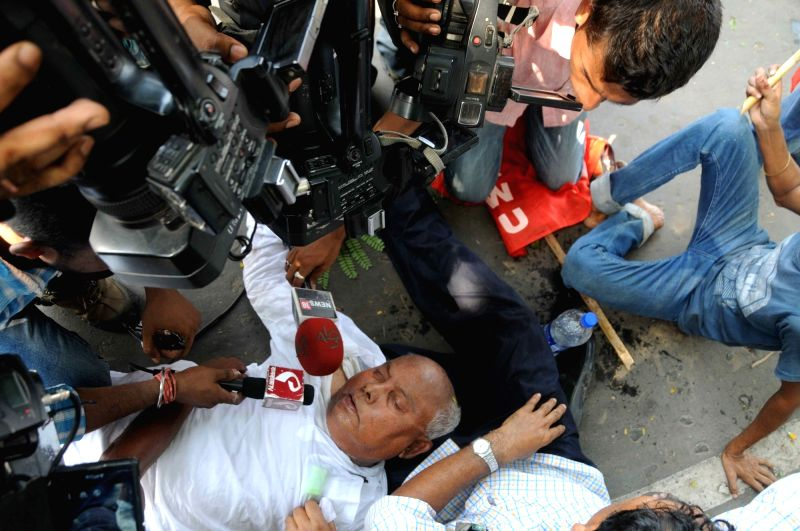 CPI-M veteran and former West Bengal minister Kanti Ganguly gets injured during a clash between workers of parties affiliated to the Left Front and police after a number of Left Front MLAs ... - Kanti Ganguly and Sujan Chakraborty