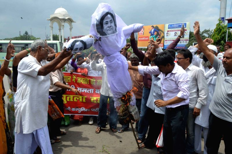CPI(M) workers burn an effigy of West Bengal Chief Minister Mamata Banerjee during a protest rally in Patna on Aug. 6, 2016. - Mamata Banerjee