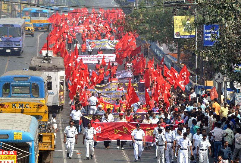 CPI(M) workers participate in a rally against the West Bengal Government in in Kolkata, on Feb 22, 2015.