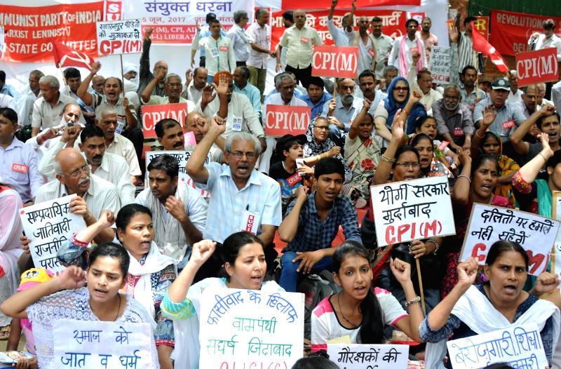 CPI-M workers stage a demonstration against Saharanpur violence in New Delhi, on June 5, 2017.