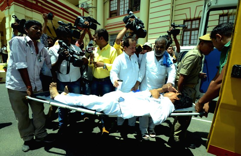CPI-ML legislator Mahbub Alam who got injured while demonstrating in Bihar Assembly being taken away for treatment in Patna on Aug 4, 2016.
