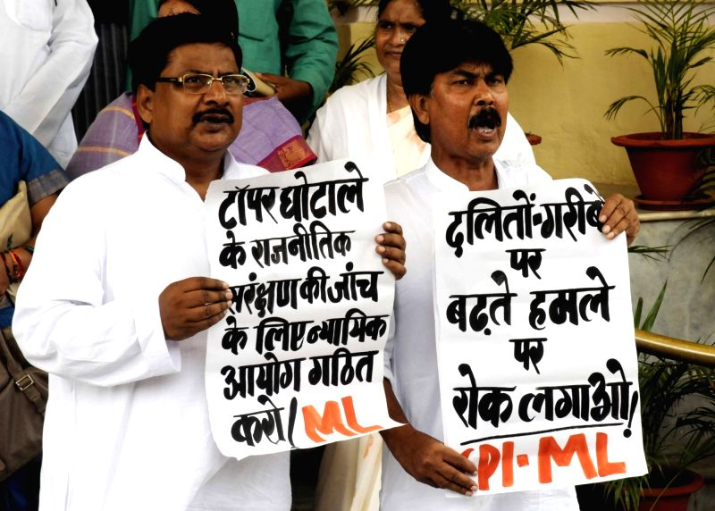 CPI-ML legislators stage a demonstration to press for their demands at Bihar assembly in Patna on Aug 1, 2016.