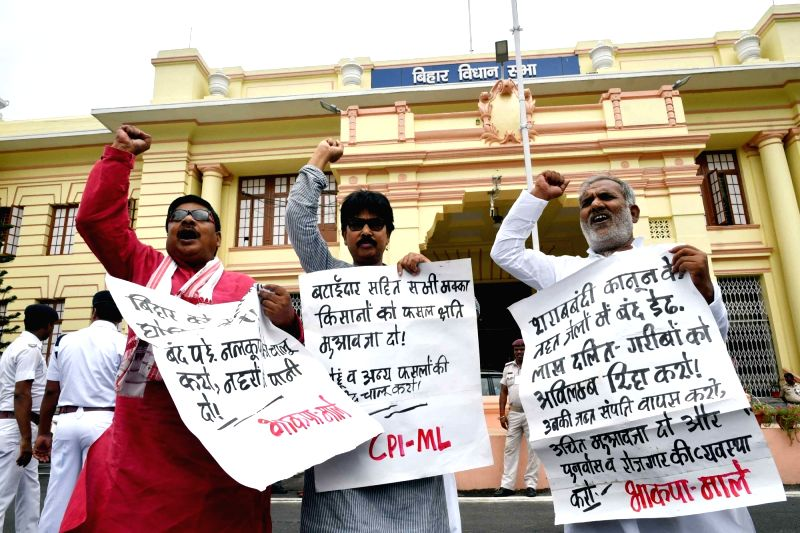 CPI-ML legislators stage a demonstration to press for their demands at Bihar Assembly in Patna on July 23, 2018.