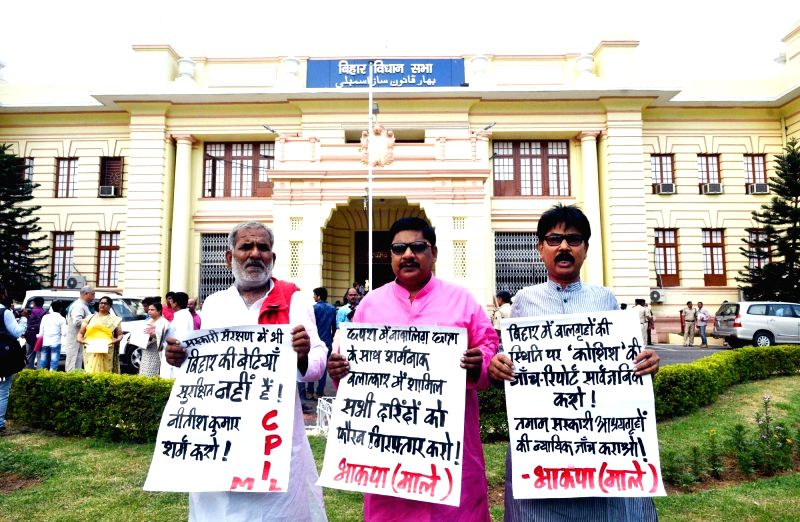 CPI-ML MLAs stage a demonstration to press for their demands at Bihar assembly in Patna on July 20, 2018.