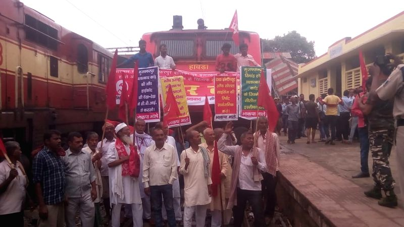CPI-ML workers block the railway tracks and disrupt railway services as they stage a demonstration during a shutdown called by the Left parties in Bihar against the rape of 34 minor girls ...