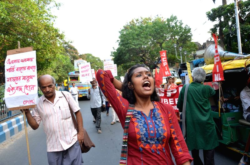 CPI-ML workers stage a demonstration against political clash in Jadavpur University in Kolkata, on May 11, 2016.