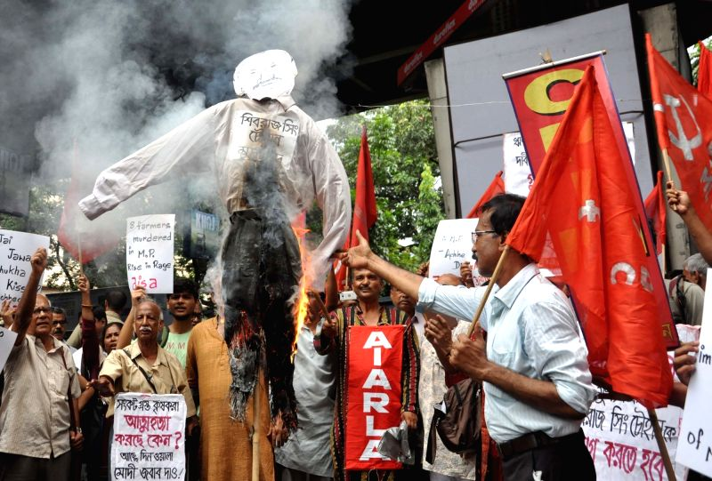 CPI(ML) workers stage a demonstration against killing of five farmers in Madhya Pradesh's Mandsaur district; in Kolkata on June 9, 2017.