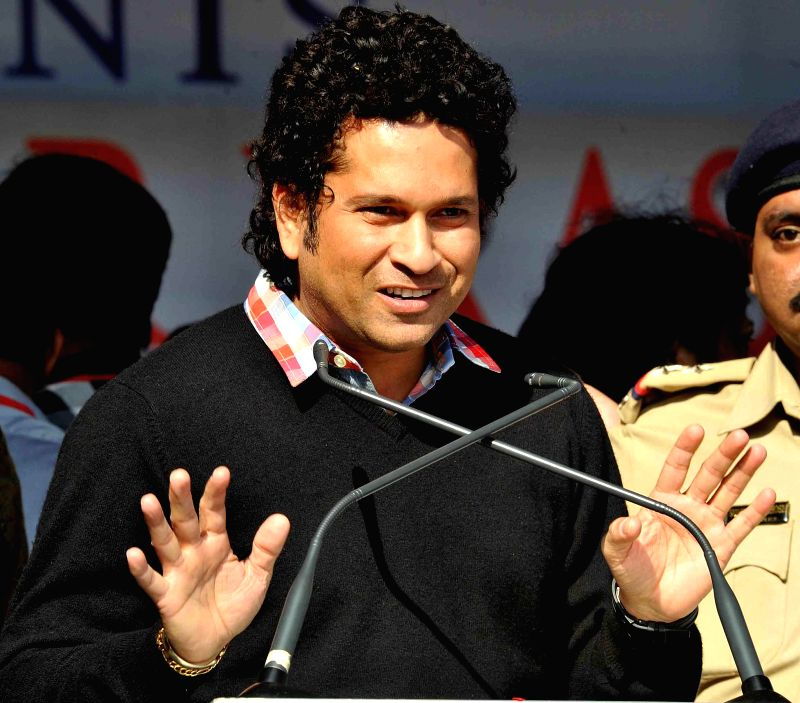 Cricket legend Sachin Tendulkar addresses at the inauguration of a swimming training institute at Rajarhat, in Kolkata, on Dec 18, 2014.