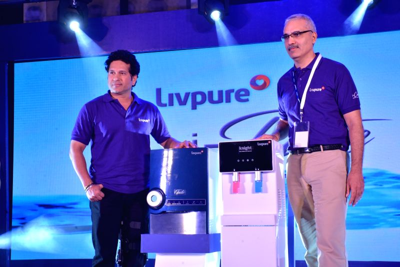 Cricket legend Sachin Tendulkar and Livpure Co-founder and Chairman Navneet Kapoor during the launch of Livpure's Smart RO and Air Purifier in New Delhi on Aug 10, 2016. - Sachin Tendulkar and Navneet Kapoor