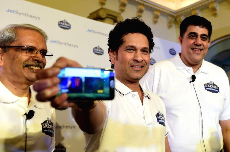"Cricket legend Sachin Tendulkar with JetSynthesys Non Executive Chairman Kris Gopalakrishnan and Vice President and Managing Director Rajan Navani at the launch of the game ""Sachin ... - Sachin Tendulkar"