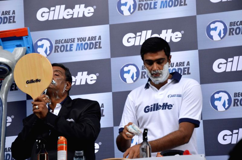 Cricket player R Ashwin with his father N Ravichandran during an event organized to celebrate a nationwide campaign `Because You Are A Role Model` by Gillette in Mumbai on June 17th, 2014.