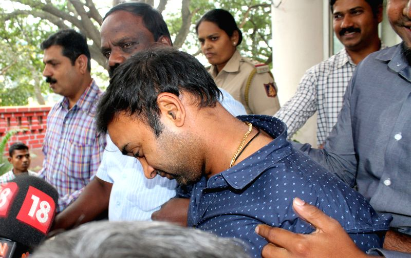 Cricketer Amit Mishra at Ashok Nagar Police Station after he was arrested by Bengaluru City police for allegedly assaulting his girlfriend in a city hotel; in Bengaluru, on Oct 27, 2015.