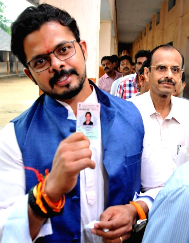 Cricketer and BJP candidate S Sreesanth after casting his vote during Kerala assembly polls in Kochi of Kerala on May 16, 2016.