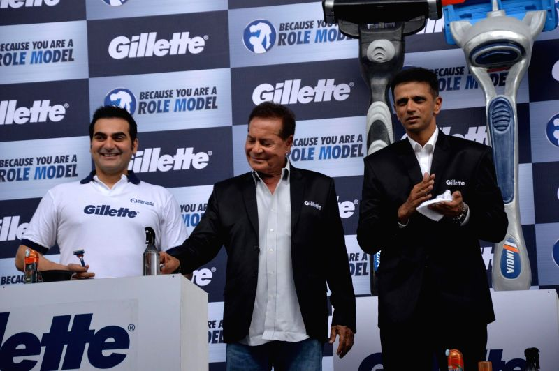 Cricketer Rahul Dravid, actor and filmmaker Arbaaz Khan, his father and Bollywood screenwriter Salim Khan during an event organized to celebrate a nationwide campaign `Because You Are A Role Model` .. - Rahul Dravid and Arbaaz Khan