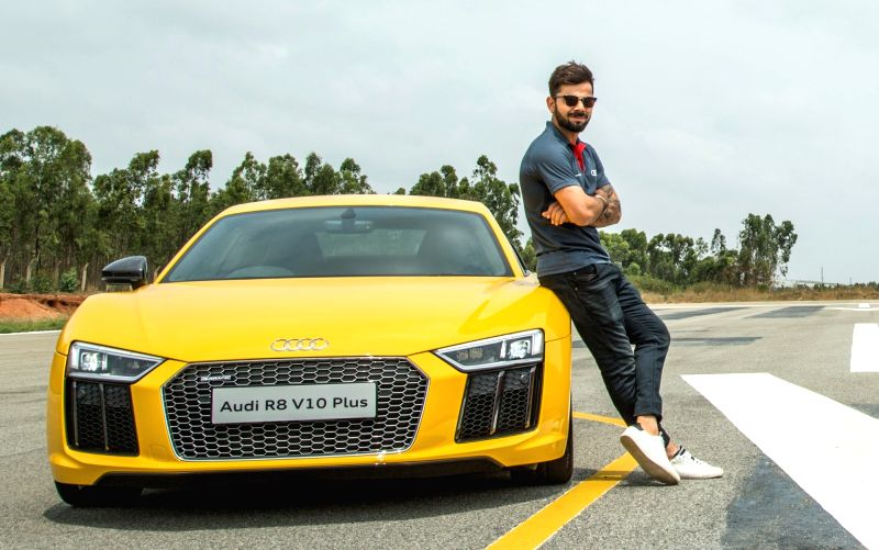 Cricketer Virat Kohli with Audi India Head Joe King at the launch of Audi R8 V10 Plus at Taneja Aerospace and Aviation Limited on the outskirts of  Bengaluru on May 19, 2016. - Virat Kohli