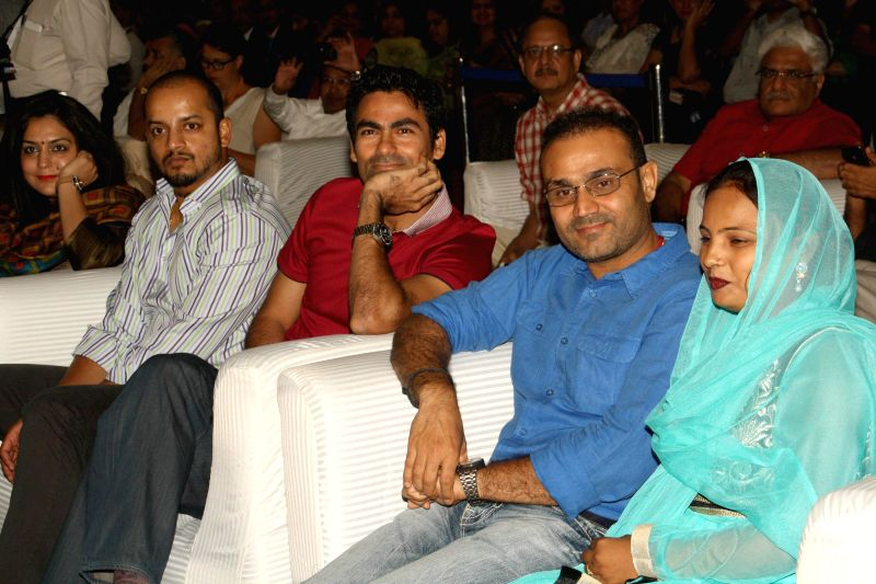 Cricketer Virender Sehwag, Murali Kartik and Mohammad Kaif during a `Polio Free India` felicitating ceremony in New Delhi on July 27, 2014.