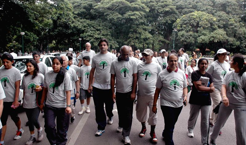 Cricketers Javagal Srinath and Vijay Bharadwaj during a walkathon organised by Charity Service of Bangalore  (CSB) in Bangalore on Aug 3, 2014.