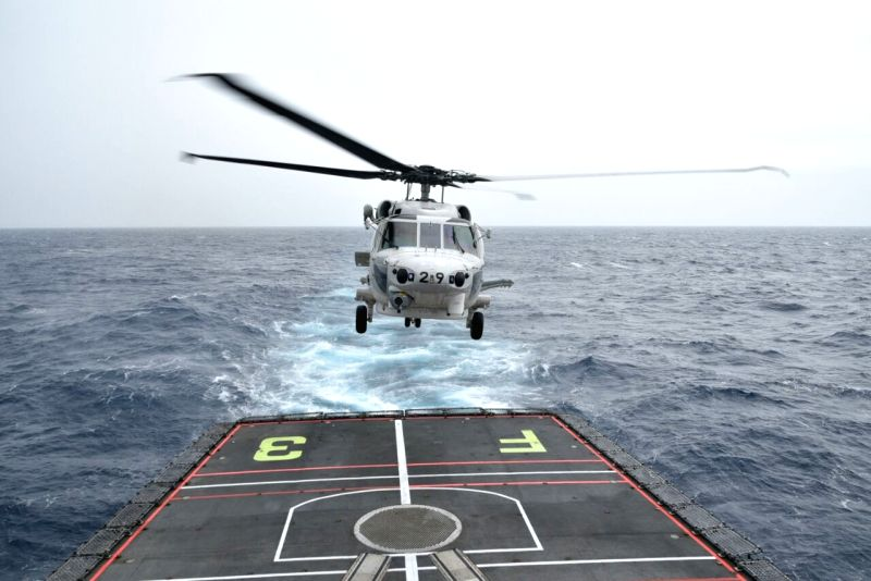 Cross deck landing of helicopters during trilateral 'Malabar' naval exercise between India, the US and Japan in the Bay of Bengal. Chetak of Indian Navy landed on JS Sazanami, SH60K ...
