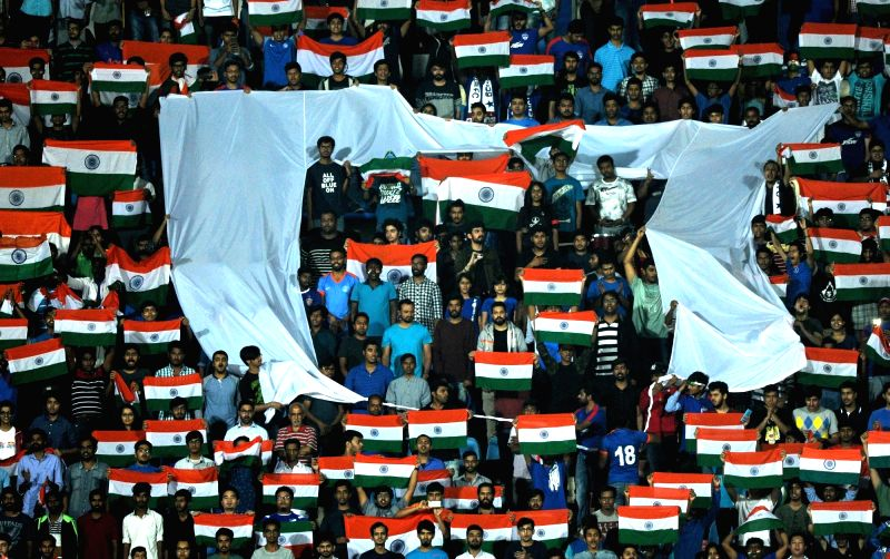 Crowd cheer for India during an AFC Asian Cup UAE 2019 qualifying match between India and Kyrgyz Republic in Bengaluru on June 13, 2017.