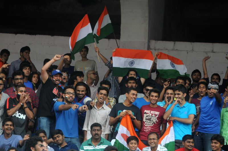 Crowd cheers during a friendly football match against Pakistan at Bangalore Football Stadium on Aug 17, 2014. India won. Score: 1-0.