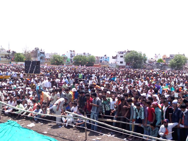 Crowd gathers at BJP Prime Ministerial candidate and Gujarat Chief Minister Narendra Modi's Rally in Ratlam district of Madhaya Pradesh on April 16, 2014.