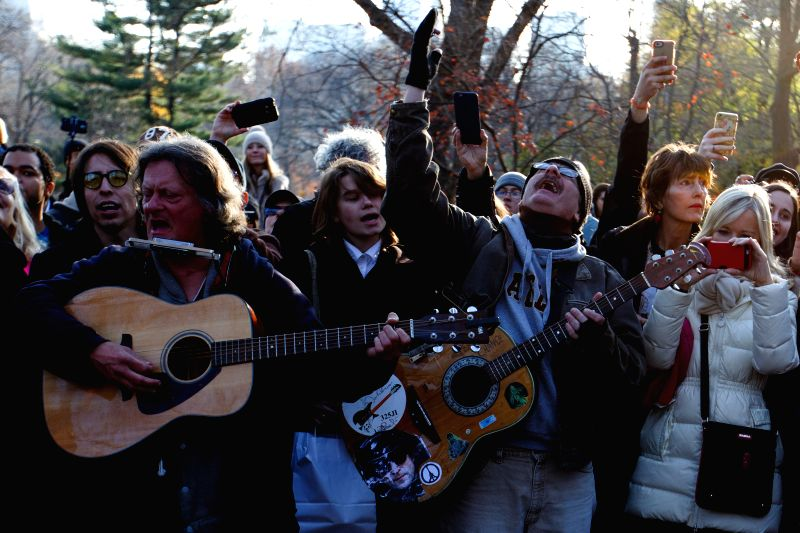 Crowds gathered in Central Park's Strawberry Field to commemorate the 35th anniversary of John Lennon's death in New York, the United States on Dec. 8, 2015. John ...