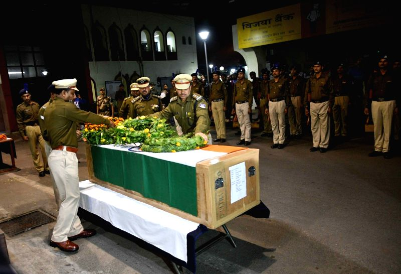CRPF officials pay floral tributes to Mujahid Khan constable who was killed in a terrorist attack at the Indian Army's Sunjuwan military camp in Jammu at Jai Prakash Naryan international ... - Khan