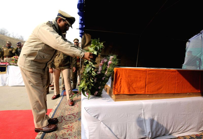 CRPF personnel pay tribute a CRPF soldier who was among the 13 CRPF soldiers killed in Dec 1 gun battle with Maoists in Chhattisgarh, in Pulwama district of Jammu and Kashmir on Dec 4, 2014.
