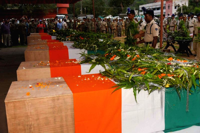CRPF personnel pays tribute to the 10 CRPF troopers gunned down by Maoists on Monday (18 July) near the border of Imamganj and Aurangabad police station; in Gaya on July 19, 2016.