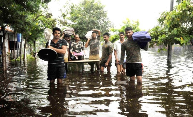 CRPF soldiers leave their flooded camp in Patna on Aug 18, 2014.