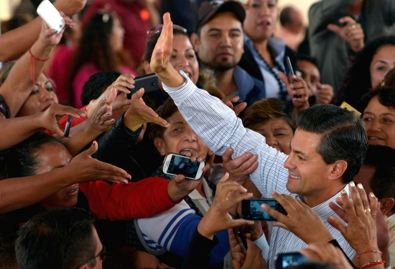 Cuautitlan (Mexico):  Image provided by Presidency of Mexico shows Mexican President Enrique Pena Nieto (R) greeting his supporters during the opening of the City of Health for the Woman, in ...