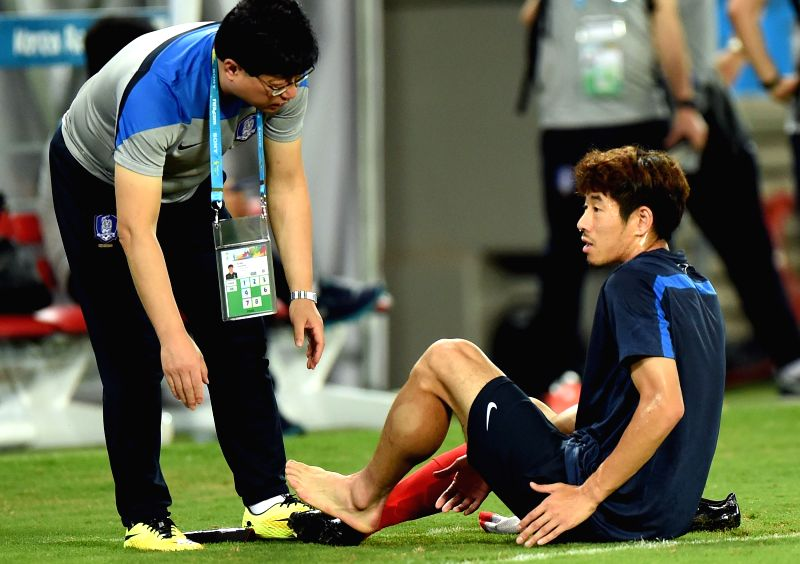 Korea Republic's Ha Dae-Sung lies down on the field because of the pain on foot during a training session of 2014 FIFA World Cup at the Arena Pantanal Stadium in ...