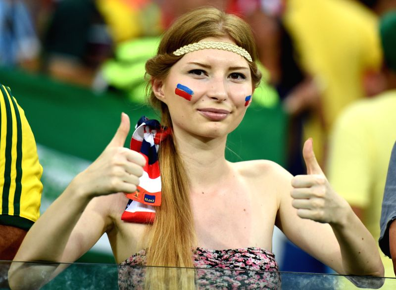 A Russia's fan poses before a Group H match between Russia and Korea Republic of 2014 FIFA World Cup at the Arena Pantanal Stadium in Cuiaba, Brazil, June 17, ...