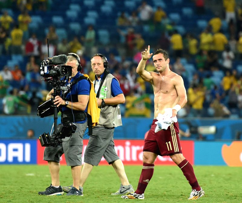 Russia's Aleksandr Kerzhakov (R) gestures to the audience after a Group H match between Russia and Korea Republic of 2014 FIFA World Cup at the Arena Pantanal ...