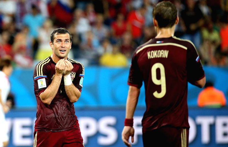 Russia's Aleksandr Kerzhakov (L) reacts during a Group H match between Russia and Korea Republic of 2014 FIFA World Cup at the Arena Pantanal Stadium in Cuiaba, ...