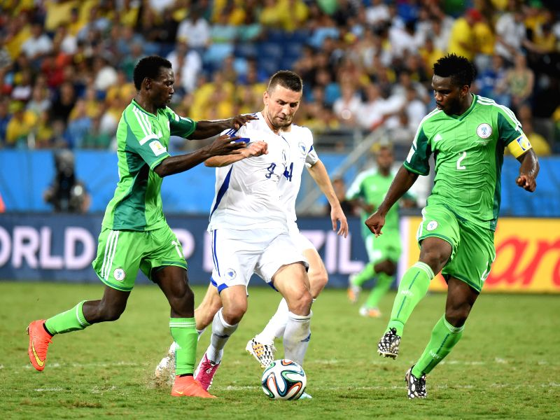 Bosnia and Herzegovina's Vedad Ibisevic (C) controls the ball during a Group F match between Nigeria and Bosnia and Herzegovina of 2014 FIFA World Cup at the Arena ..