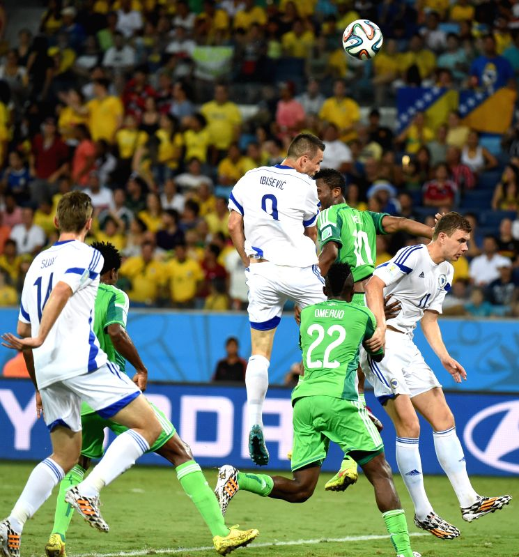 Nigeria's Babatunde Michael (up R) vies with Bosnia and Herzegovina's Vedad Ibisevic (up L) during a Group F match between Nigeria and Bosnia and Herzegovina of 2014