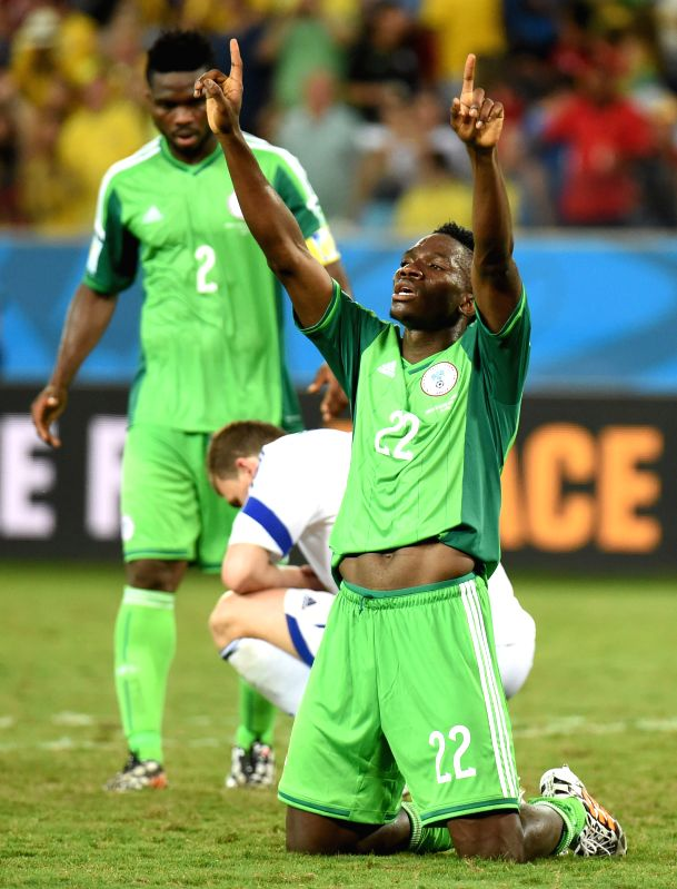 Nigeria's Kenneth Omeruo (front) celebrates the victory after a Group F match between Nigeria and Bosnia and Herzegovina of 2014 FIFA World Cup at the Arena Pantanal